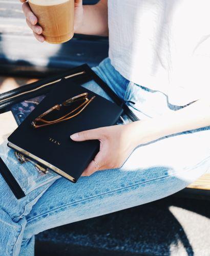woman journal coffee
