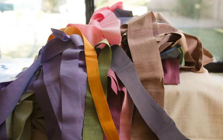 Cut a small mountain of strips between one and four inches wide the full width of your fabric.