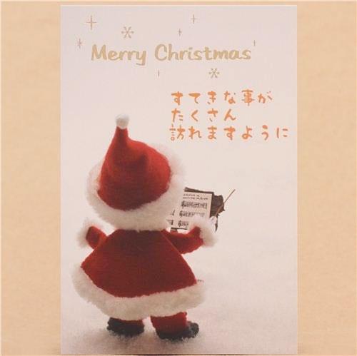 Tarjeta de navidad de papa noel tocando la batuta