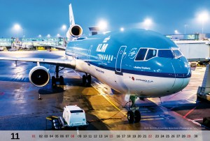 The November motive of the MD-11 Calendar 2015 is KLM PH-KCA at the gate in Amsterdam during night.