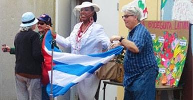 photo of Fellowship House members waving the flag