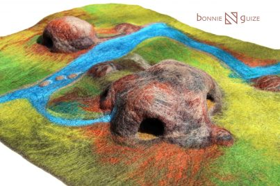 Wow, this felted playscape for cavemen and sabre-tooth tigers! This is my favourite part of history! This mat also made out of wool entirely a been wet-felted to be strong and durable.