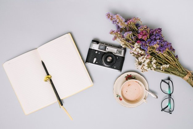 8 Things to Do After Starting a New Blog notebook with camera flowers table 23 2148043858