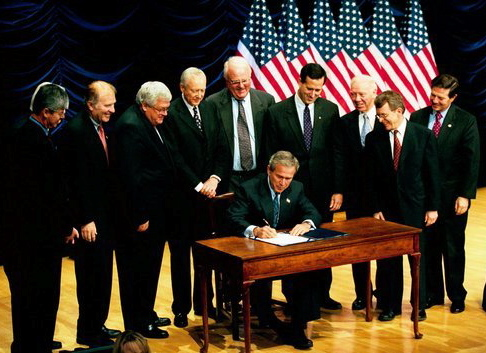 President Bush signs the Partial Birth Abortion Act.