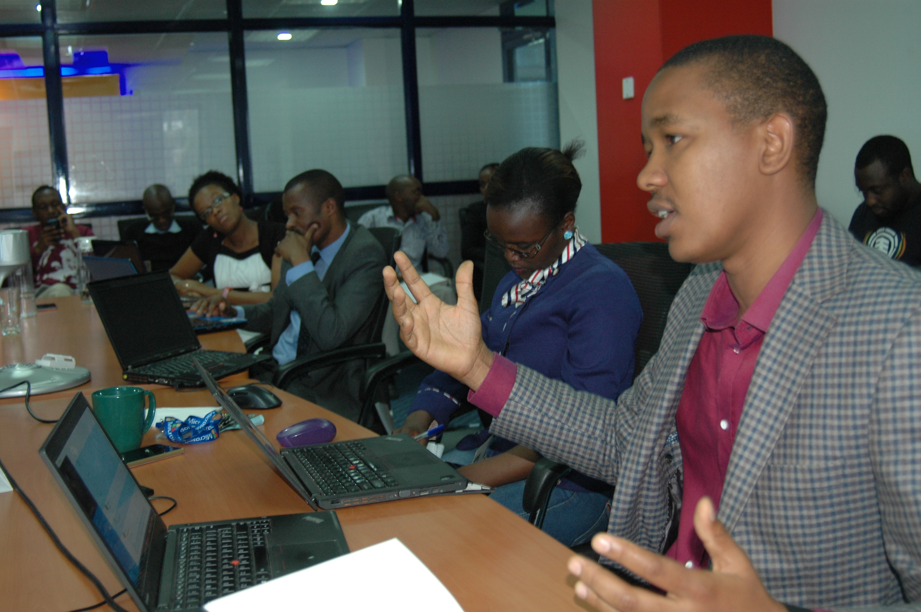 Product Manager, Microsoft Mobile, Mr. Kingori Gitahi, addresses journalists and bloggers during a media round-table to launch Microsoft Swahili Translator in Nairobi.