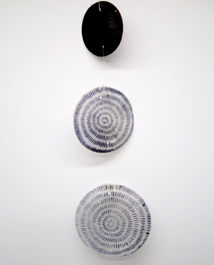 Garland of mother of pearl painted into a mix of patterns with black and white