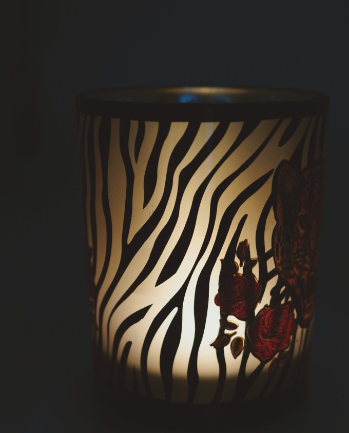 Votive of tealight glass with a leopard head