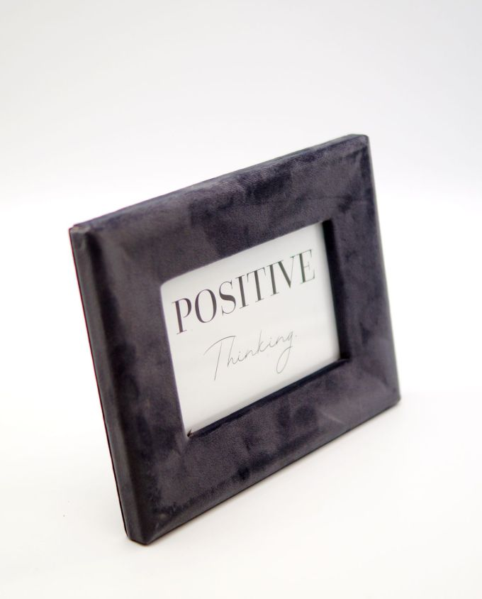 Wooden picture frame with grey velvet fabric exterior