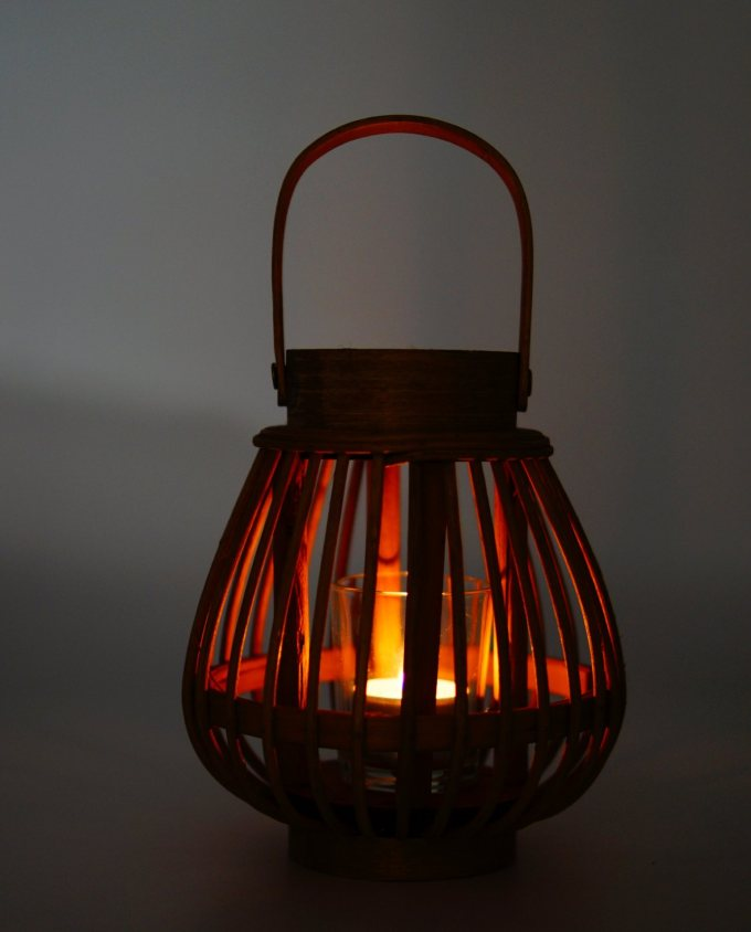 Lantern made of brown color bamboo with glass included.