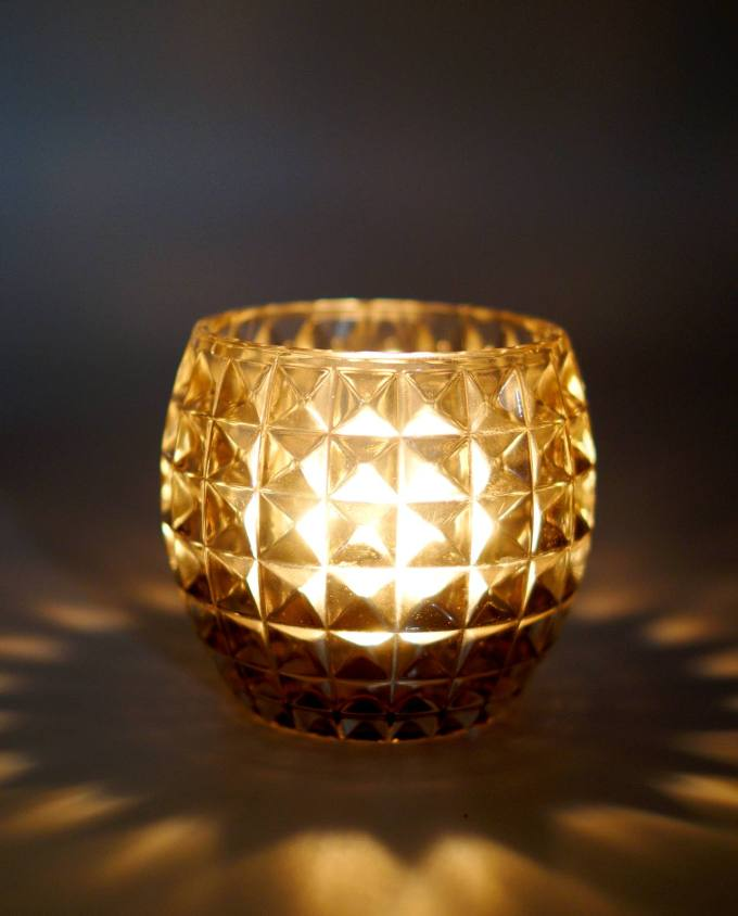 Votive of heavy tealight clear glass lighted