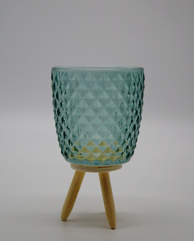 Votive of tealight light green glass with wooden legs