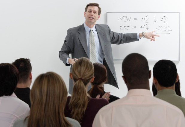 Businessman Conducting Meeting --- Image by © Royalty-Free/Corbis