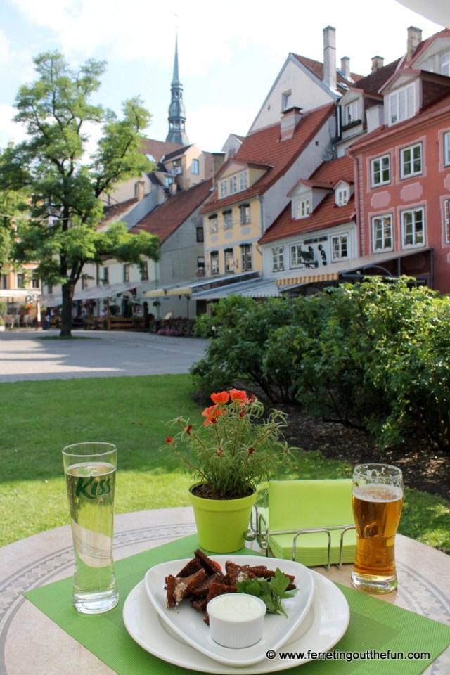 Enjoying summer in Riga, Latvia with pear cider and fried garlic bread