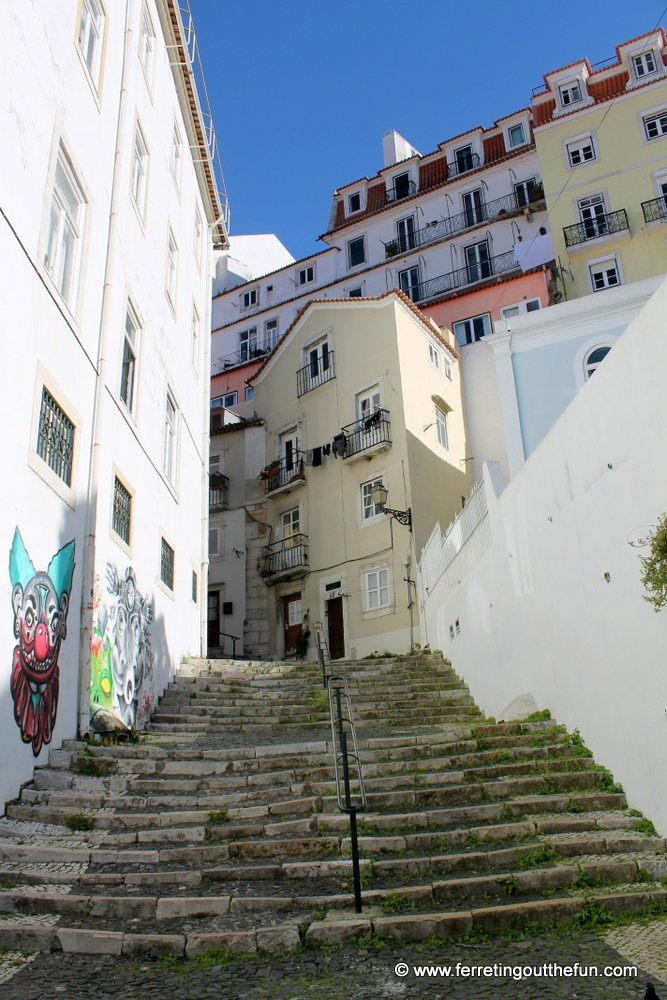Stairs and street art in the Alfama district of Lisbon, Portugal.