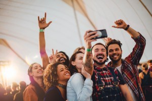 group-of-friends-taking-selfie-at-music-festival