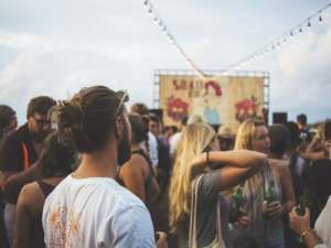 crowd-of-people-at-music-festival-with-young-man-in-foreground