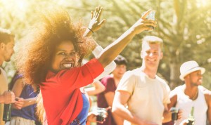 young-woman-dancing-in-crowd-at-outdoor-music-festival