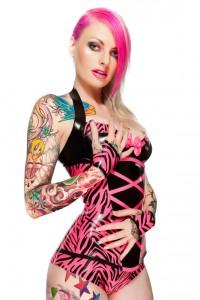 Vibrant pink zebra print corset, bra, underwear, and glove set