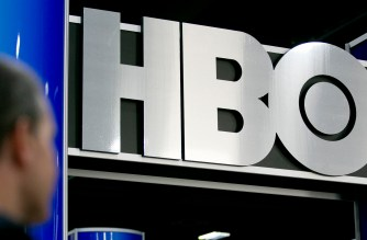 The logo of Home Box Office Inc. (HBO) is seen on the exhibit floor during the National Cable and Telecommunications Association (NCTA) Cable Show in Washington, D.C., U.S., on Tuesday, June 11, 2013. The Cable Show is expected to bring in more than 10,000 attendees with 286 companies on the exhibit floor. Photographer: Andrew Harrer/Bloomberg via Getty Images
