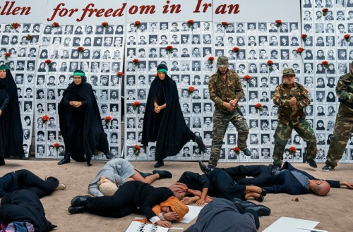 Activists act out human rights abuses as they gather outside the United Nations headquarters in New York on Wednesday, Sept. 20, 2017. The rally, organized by the Organization of Iranian American Communities, highlighted human rights abuses and called for democratic change in Iran. (AP Photo/Andres Kudacki)