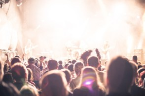 Crowd of people at a concert, bright lights
