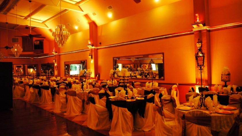 Herreras Reception Hall Amber LED Uplights Full Side Wall From Entrance