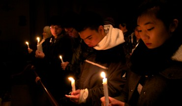 A candlelight vigil for the Dream Act at St Theresa's Church in Manhattan - Photo: Braden Goyette