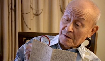 Paul Loong reading from his secret WWII diary