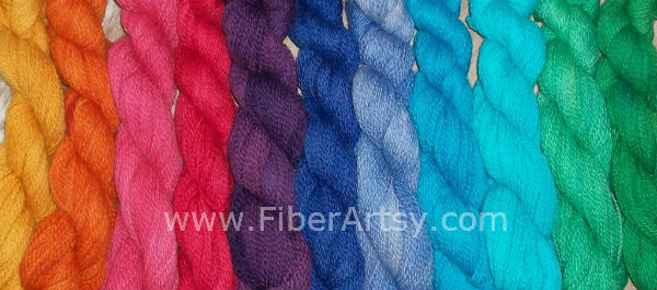 Skeins of hand dyed yarn in a rainbow of colors. Immersion Dyeing Yarn Method