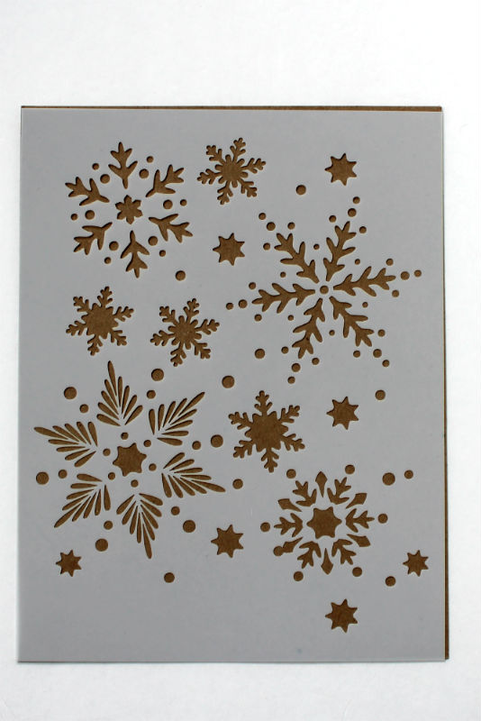 Christmas Stencil used to paint a Greeting Card and Cotton Kitchen Towel