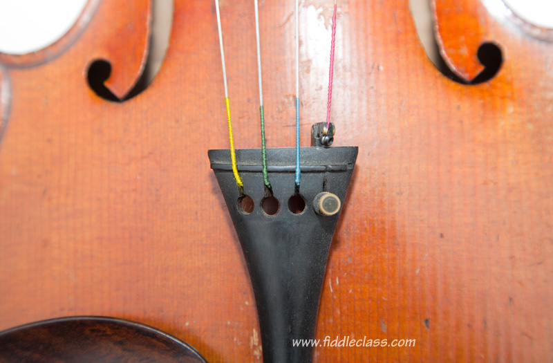 A single adjuster on the e string of a fiddle