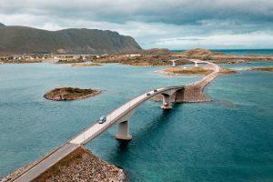 Nur the van driving along a bridge in Lofoten Islands