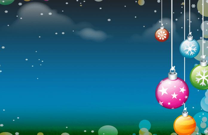foto de tarjeta navideña con fondo de estrellas y bolas de adorno