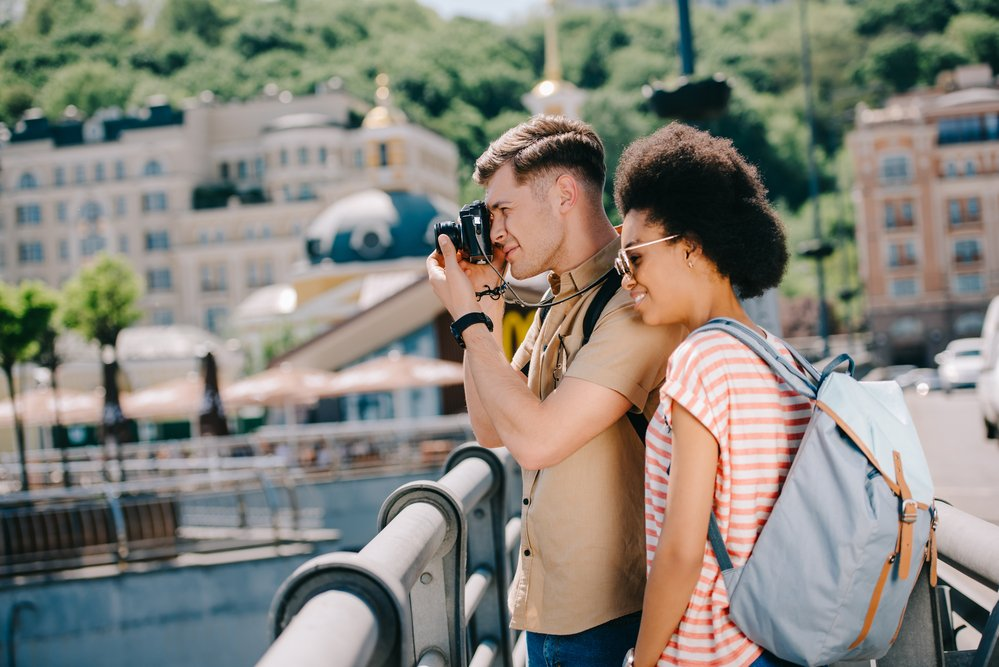 Traveling couple taking a photo