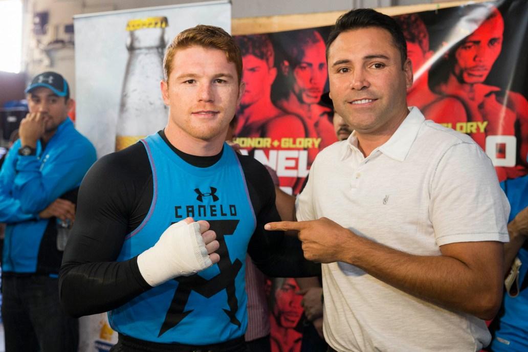 https://i2.wp.com/www.fightweek.com/wp-content/gallery/honor-glory-canelo-alvarez-media-workout-quotes-photos/003_Canelo_and_Oscar_de_la_Hoya.jpg?resize=1032%2C688