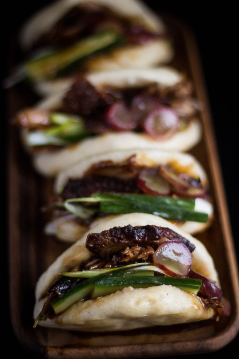 steamed buns with duck and pickled grapes