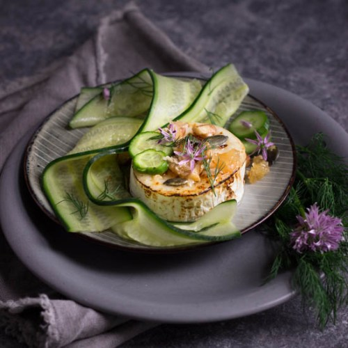 Caramelised goats cheese with pickled cucumber, walnuts and honey