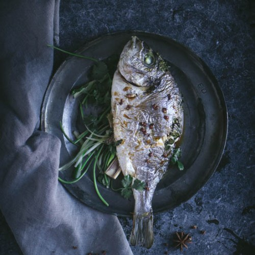 Sea bream en papilotte with ginger and anise