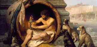 """Diógenes en su tinaja rodeado de perros. De ahí viene el nombre de los cínicos, del griego """"kyon"""", perro."""