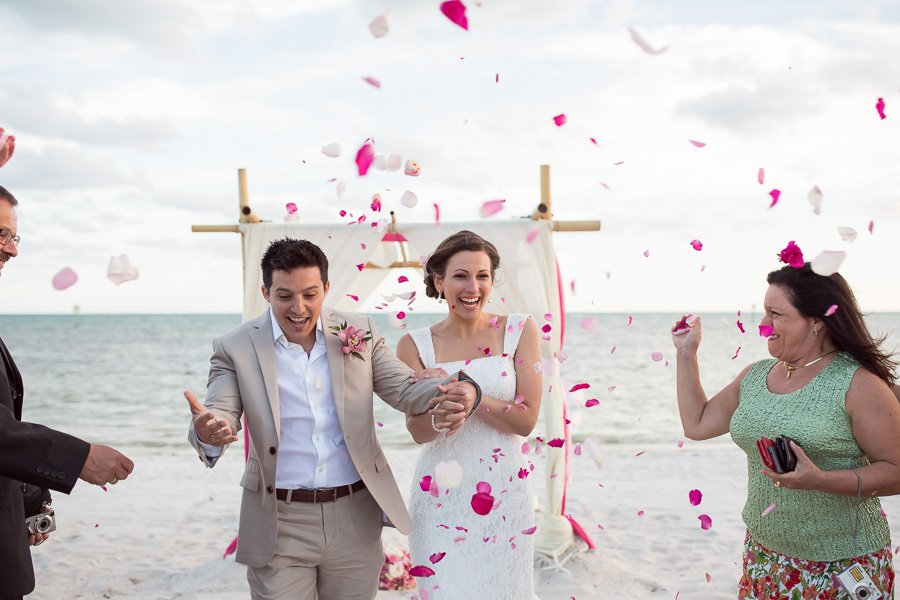 bride and groom exit their beach ceremony