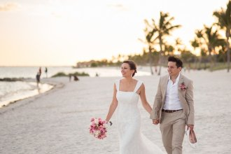 bride and groom walking down the smathers beach in key west florida