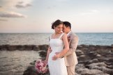 bride and groom posing for their wedding photo on smathers beach in key west florida