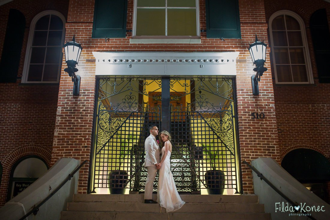 bride and groom standing on stairwell near duval street