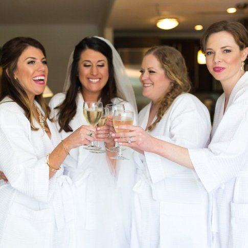 bride with her bridesmaids celebrating