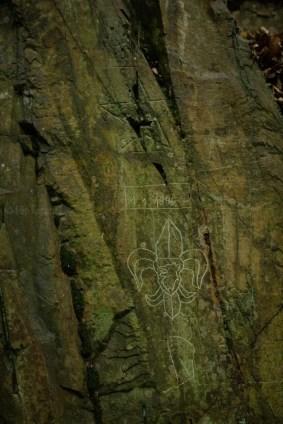 scout emblem carved in rock