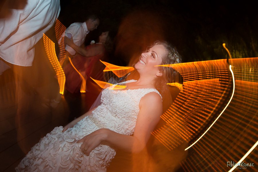 night photo of bride and groom at fort zachary state park