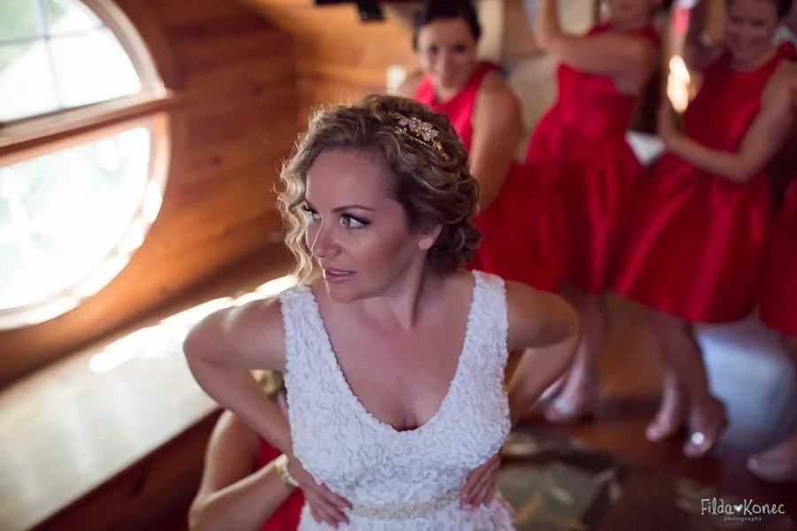 bride getting in her dress