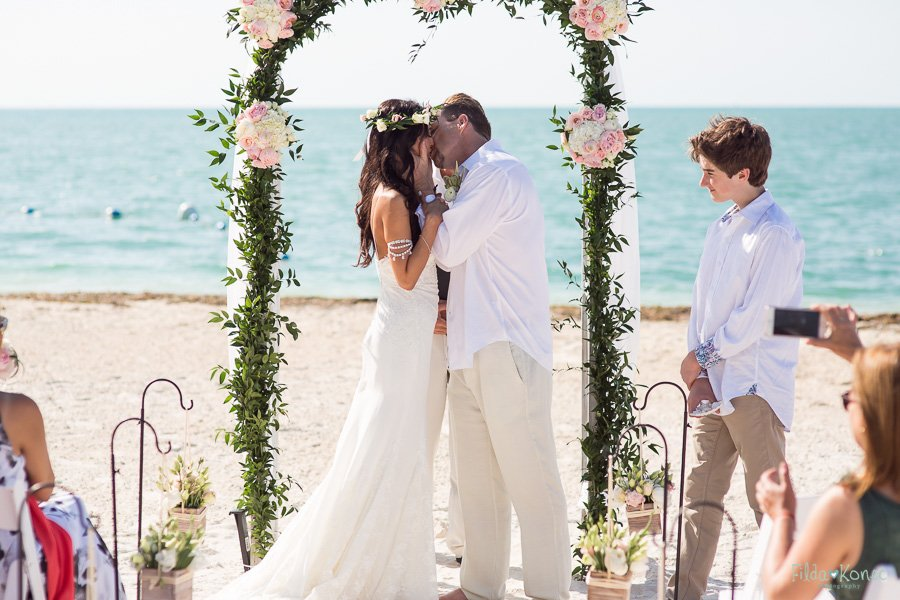 first kiss at sunset key beach wedding in key west florida