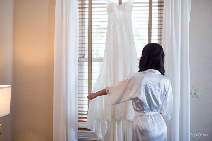 bride checks out her wedding dress before she gets in