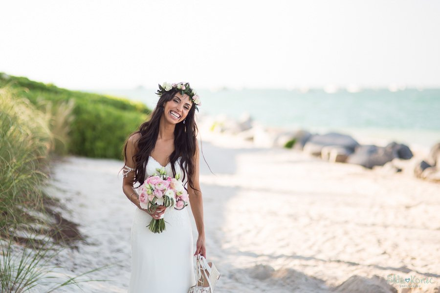 beautiful bride smiles for the camera on the beach in key west florida